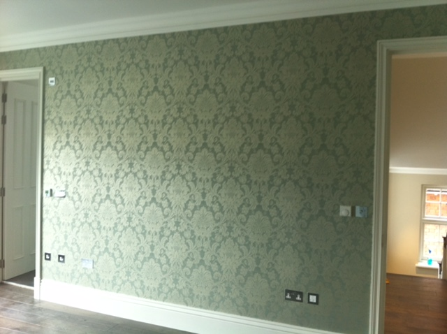 How to hang wallpaper like a professional robs decorators for Matte finish paint for walls